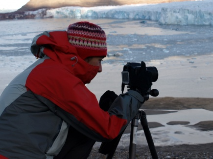 SVALBARD: Anne Chapuis photographing during fieldwork on Svalbard.