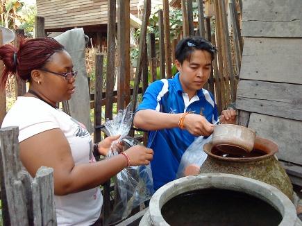 PhD students sampling water