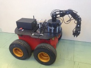 A mobile robot with a manipulator arm from Adept Mobilerobots.